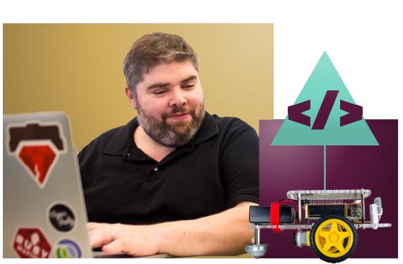 Man coding a GoPiGo Raspberry Pi robot with Python
